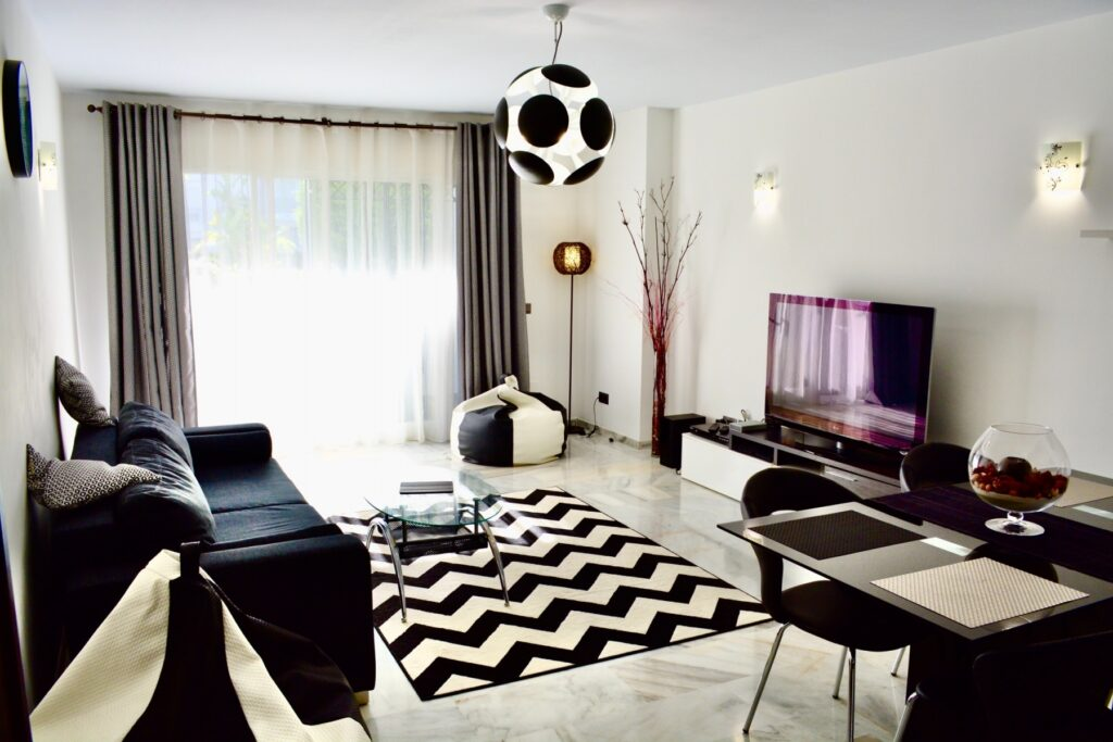 Black and white interior design to help residents to unwind by the sea